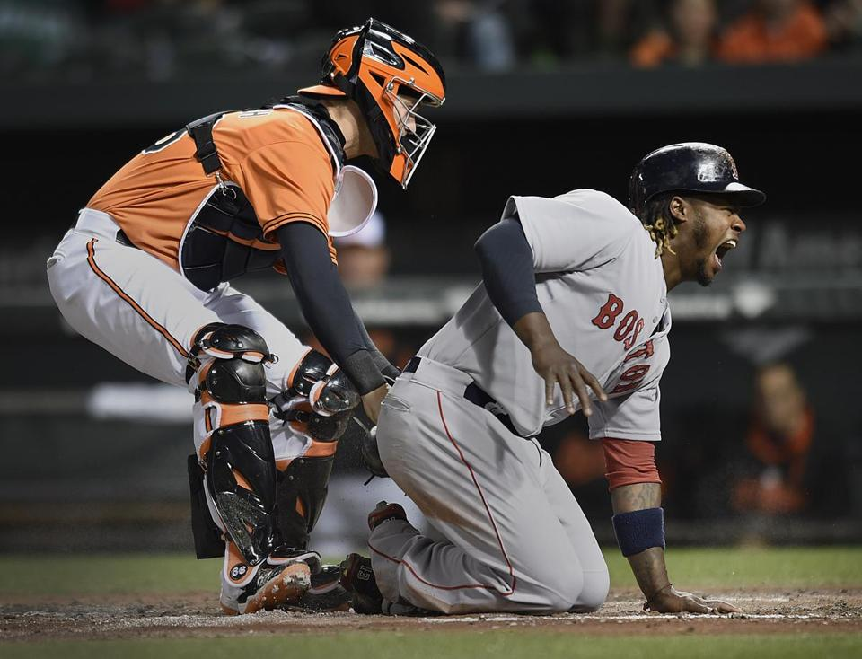 Orioles catcher Caleb Joseph tagged out Hanley Ramirez, who was trying to score the go-ahead run on Allen Craig's single in the fourth inning.